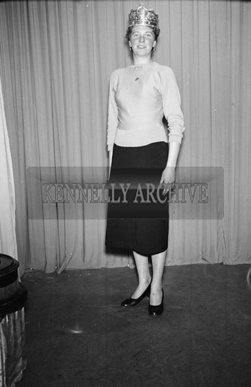 January 1956; A Studio Photo Of The Queen Of The Plough, Ms. Annie Mai Donegan, Posing For The Camera With The Sam Maguire Cup.