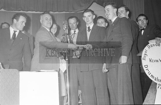 3rd February 1956; Tim Kirby Of The Kerry Ploughing Association Presents A Prize At The Abbeydorney Plough Prize Dance.