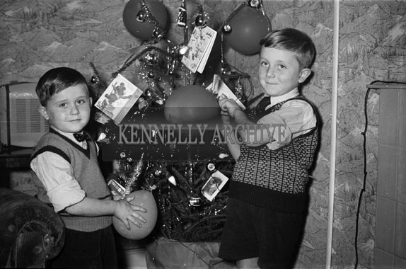 5th January 1956; The Dowling Boys Posing For The Camera In Front Of The Christmas Tree At Home In 8 Castlecountess, Tralee.