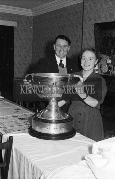 5th January 1956; A Couple Posing With The Sam Maguire Cup At The Duagh GAA Social In The Meadowlands Hotel, Tralee.