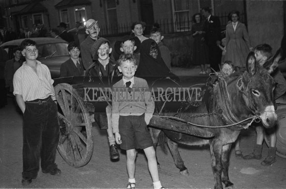 September 1956; A photo taken of people in costume at the CYMS Fancy Dress Parade in Castleisland.
