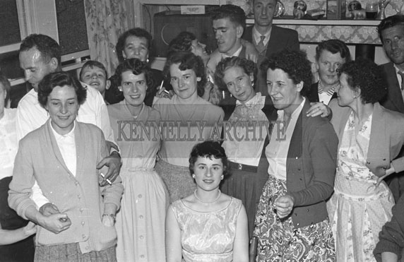 1956; People enjoying themselves at a party at the Moran House in Strand Street in Tralee.