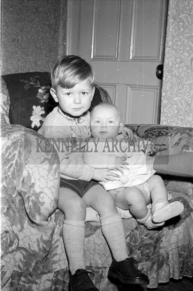 January 1956; The Dowd Boy And Baby Posing For The Camera At Home In Connor's Terrace, Tralee.