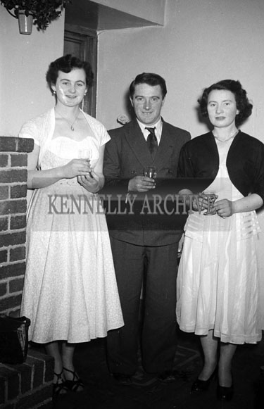 24th January 1956; Three People Posing For The Camera At The Lixnaw ICA Social In The Meadowlands Hotel, Tralee.