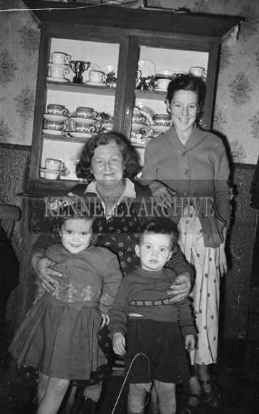 1956; A photo of a family taken at an unknown location.