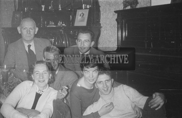 February 1956; Padraig Kennelly Senior And Joan Kennelly Posing For The Camera With Friends/Family.