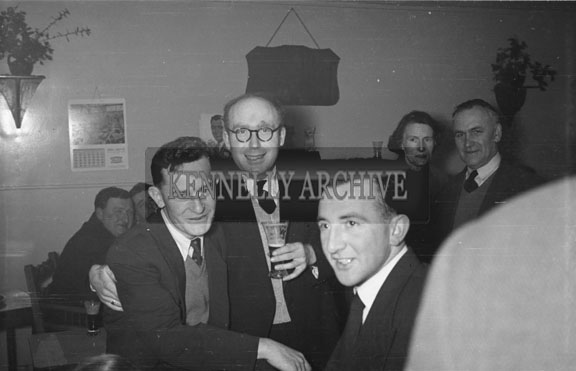 February 1956; Two Men Posing For The Camera At The Social For The Ploughing Dance Honouring Kerry's National Champions In The Meadowlands Hotel, Tralee.