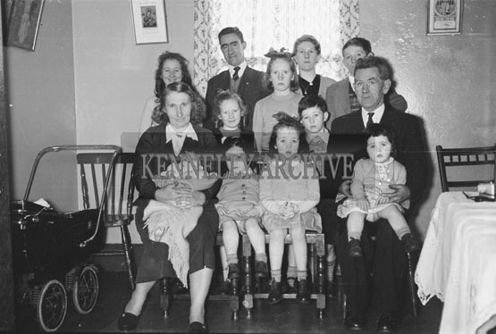 February 1956; Members Of A Family Pose For The Camera.
