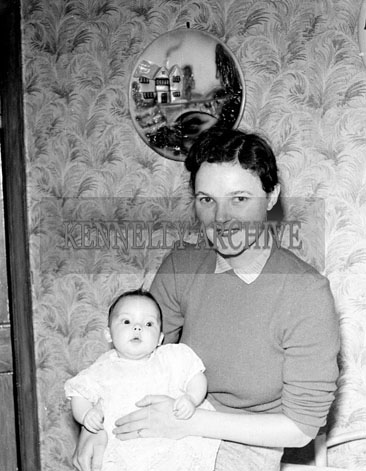 1956; A photo of a mother and baby taken at home.