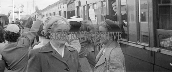 1956; A photo of the wedding party boarding the train for their honeymoon.