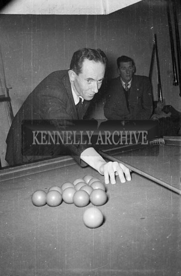 March 1956; John Charles Hoare watches a player in a snooker championship.