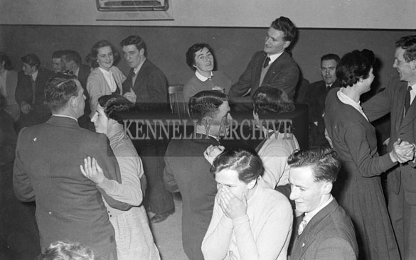 November 1956; People enjoying the night during a Macra Cup Presentation which took place at an unknown location.