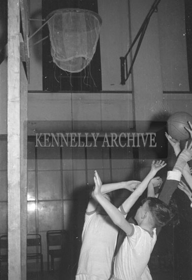 March 1956; An Action Photo From A Basketball Game.