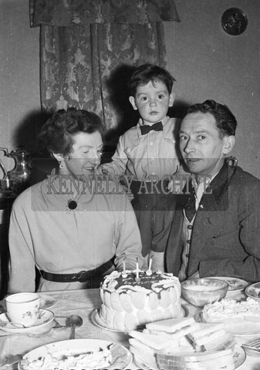 March 1956; Members Of The Family Pose For The Camera At Tommy Drummond's 3rd Birthday Party At Home At St. Brendan's Park In Tralee.