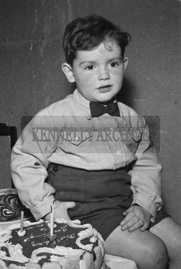 March 1956; Tommy Drummond Poses For The Camera With His Cake At His 3rd Birthday Party At Home At St. Brendan's Park In Tralee.
