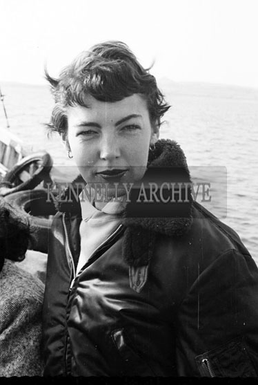 1956; A photo of Joan Kennelly in a boat off Valentia during a visit from Actor and T.V. Star Joe Lynch.