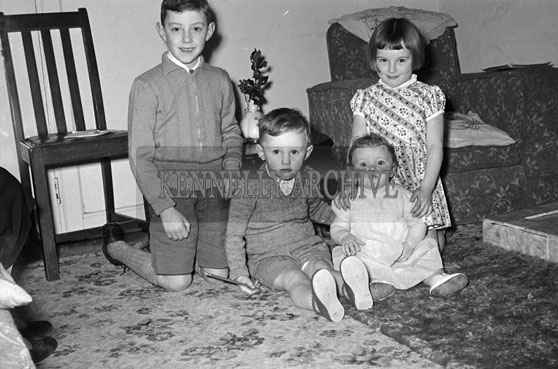 December 1956; A photo of children at Christmas in their home.