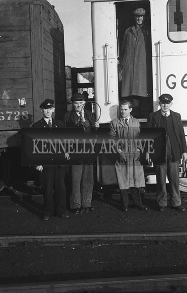 January 1957; CIE staff pose for the camera at the Train Station in Tralee.
