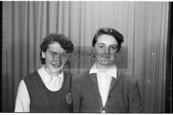 April 1956; A photo of a Mercy Secondary School teacher with a student.