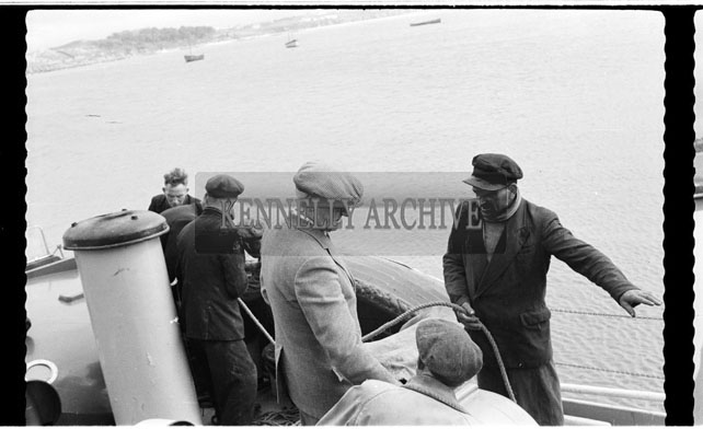 May 1956; A photo showing the Fenit Lifeboats bringing ashore the body of one of the men from the French Trawler that sank off the coast of Dingle.