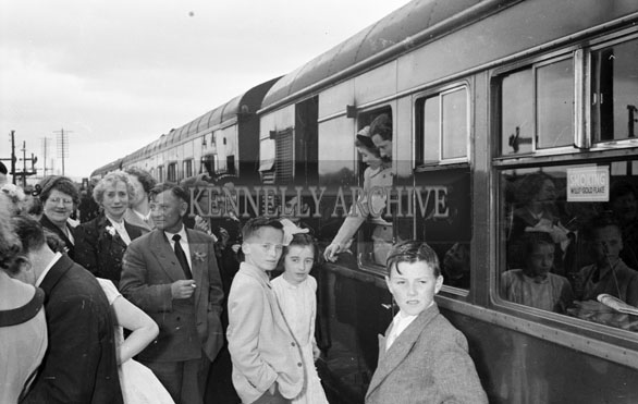 1956; A photo taken at the train station after a wedding which took place at St Catherine's Church in Tralee.
