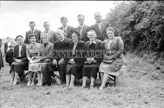 June 1956; Members of the Abbeydorney Feis Committee pose for the camera with Fr. Hurley at the Abbeydorney Feis.