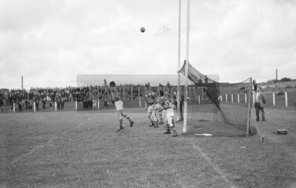 12th August 1956; An action photo during the County Championship quarter final between John Mitchels and Feale Rangers in Austin Stack Park, Tralee. Feale Rangers won 1-9 to 1-5.