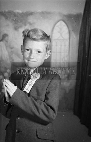 July 1956; Dermot Casey From Gortalea in Tralee poses for the camera in the studio.