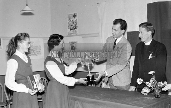 9th July 1956; Two girls receiving an award at the Irish Junior Red Cross Conference which took place in Tralee.