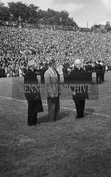 29th July 1956; A photo of the Bishop and two men taken during the Munster Final Replay in Killarney.