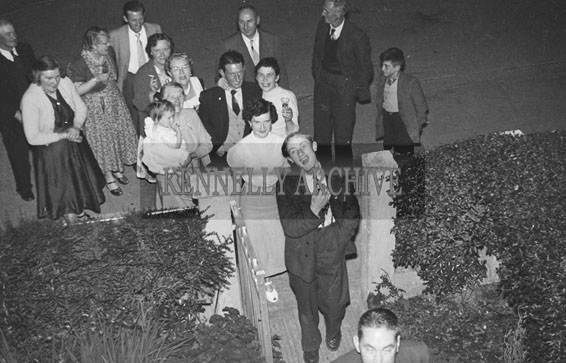 August 1956; People enjoying the night at a party in a house in Tralee.
