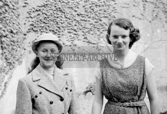 May 1957; Two girls pose for the camera on their confirmation day in Ballylongford.