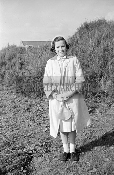 May 1957; A photo of a girl on her confirmation day in Ballybunion.