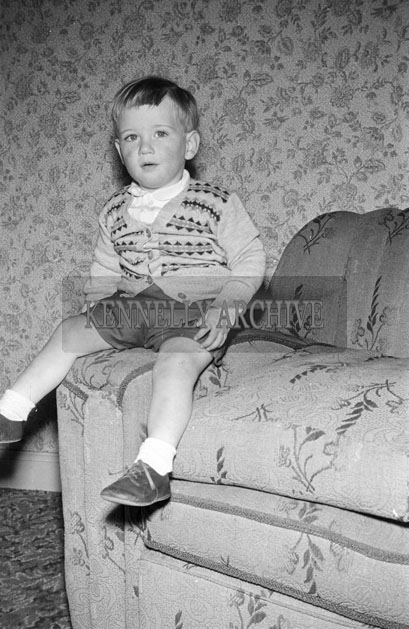 May 1957; A photo of a young boy.