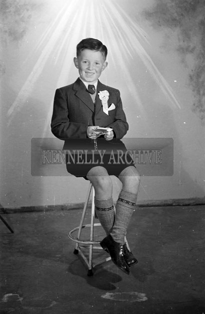 May 1957; A photo of a communion Boy, taken in the studio.