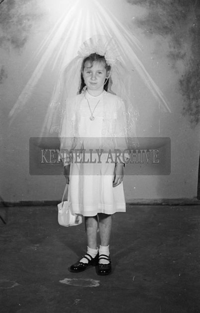 May 1957; A photo of a communion girl, taken in the studio.