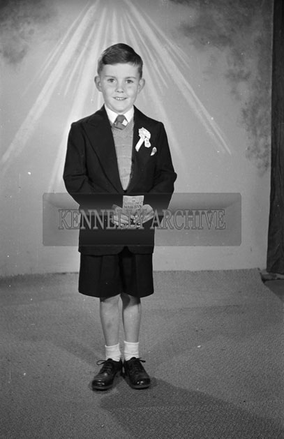 May 1957; A Communion photo of the Dillon boy, taken in the studio.