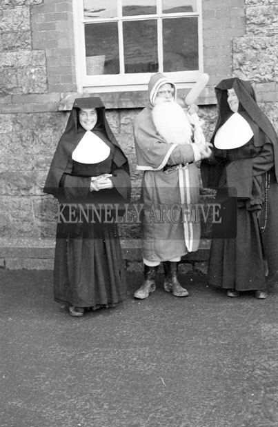 December 1957; A photo of Santa with a group of nuns at Presentation Convent School, Castleisland.