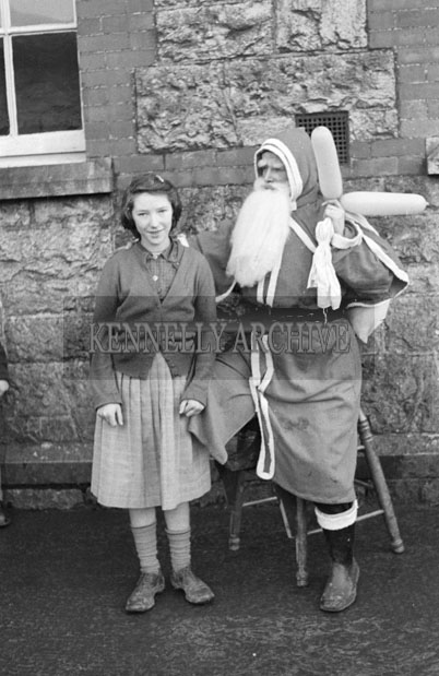December 1957; A photo of Santa with a student at Presentation Convent School, Castleisland.