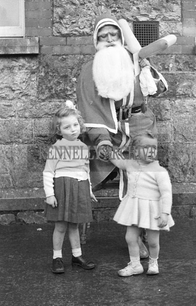 December 1957; A photo of Santa with a group of students at Presentation Convent School, Castleisland.