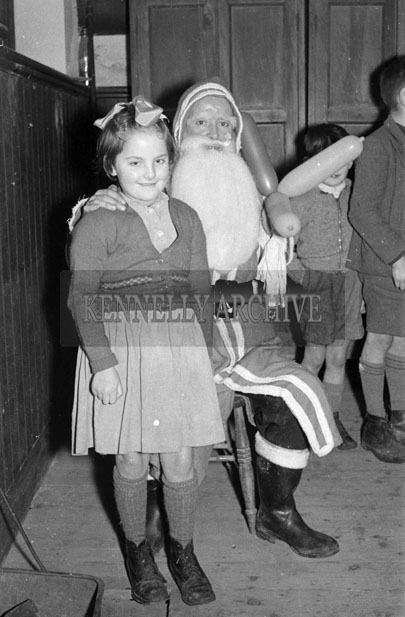 December 1957; A photo of Santa with a student at a National School near Abbeyfeale.