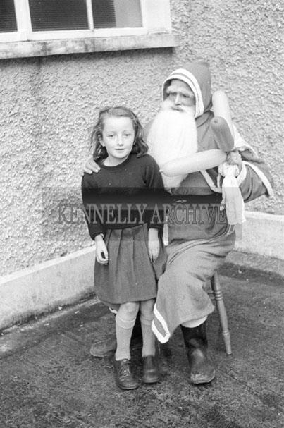 December 1957; A photo of a Santa visit to Presentation National School.