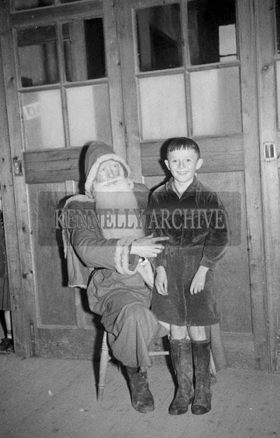 December 1957; A photo taken with Santa at a National School.