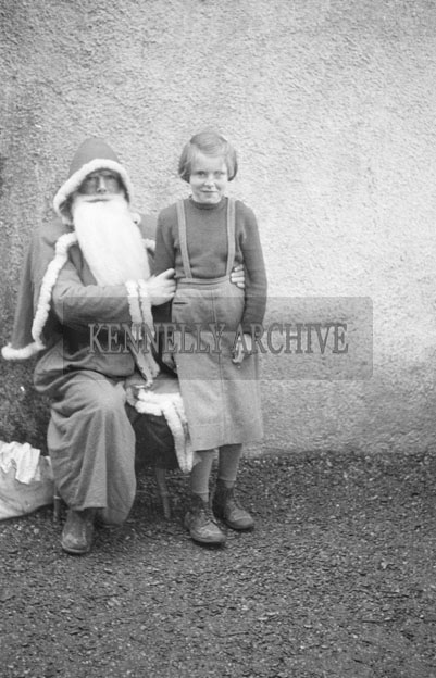 December 1957; A photo taken with Santa at Lougher National School.