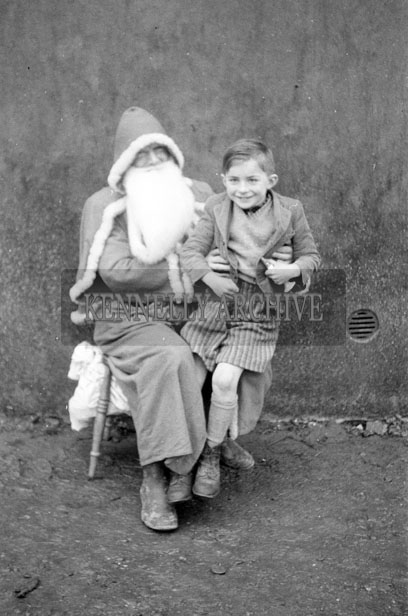 December 1957; A photo taken with Santa at Kileenagh National School.