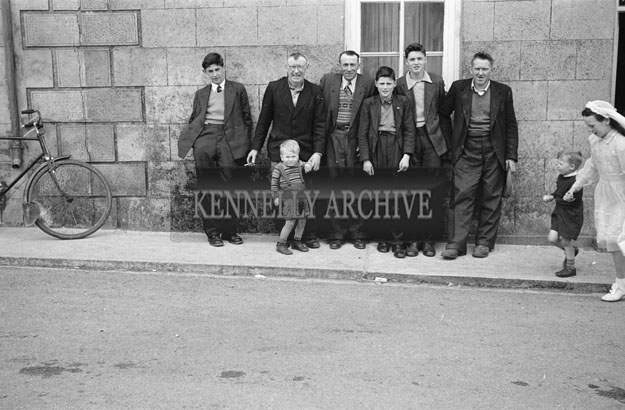 3rd May 1957; A group of men pose for the camera on Confirmation Day in Castlegregory.