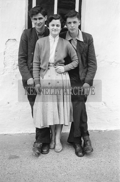 3rd May 1957; A photo of Jimmy Fitzgerald, Anna Fitzgerald and Brendan Rohan, taken on Confirmation Day in Castlegregory.