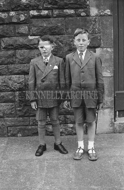 6th May 1957; Two boys pose for the camera on their confirmation day in Dingle.