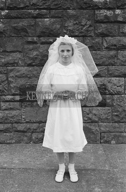 6th May 1957; A confirmation girl poses for the camera  in Dingle.