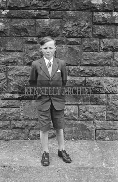 6th May 1957; A boy poses for the camera on his confirmation day in Dingle.